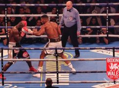 Anthony Joshua retains titles with 10th round stoppage of tough Carlos Takam